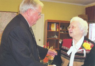 Rex Chilton with Charter Member Mary Dunn.